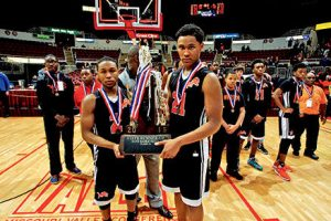 Leo senior captains Darius Branch (left) and Darias Oliver pose with the Lions' runner-up trophy after the Class 1A state championship game. Branch started every game in his Leo career with Oliver contributing as a three-year starter. The pair led the Lions this year on a memorable campaign. (photo courtesy of VIP Photography)